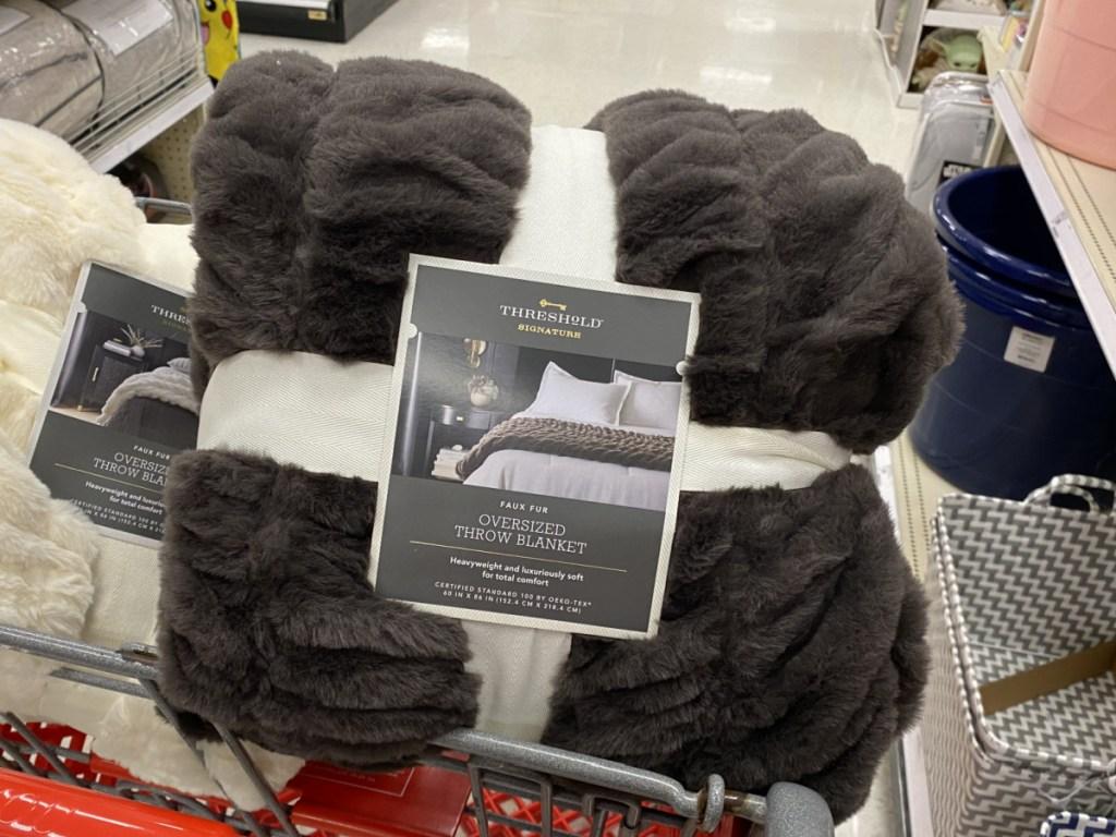 cozy Threshold faux fur throw in target shopping cart