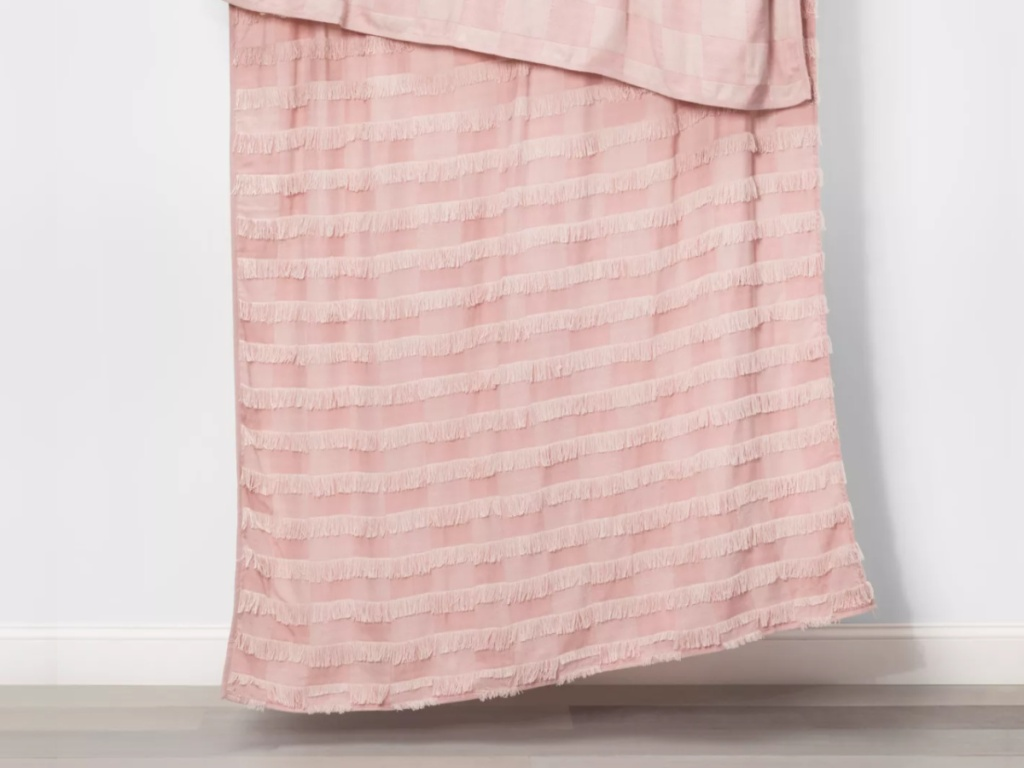 light pink throw hanging for a branch