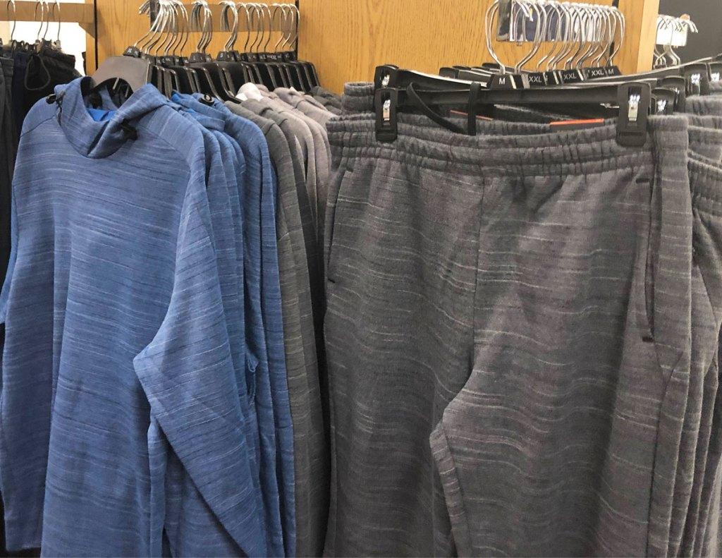 men's blue sweatshirts and grey sweatpants on black hangers on kohl's store display