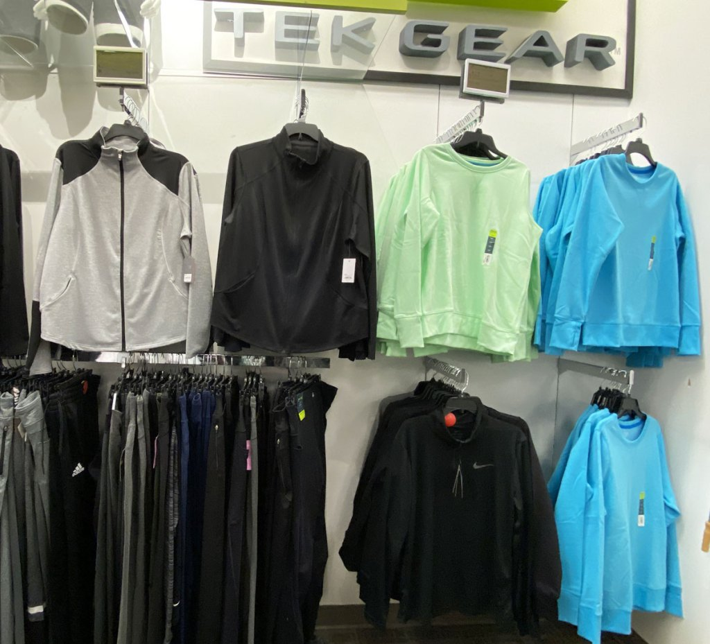 Tek Gear display wall at kohl's with various colors and styles of women's jackets and sweatpants