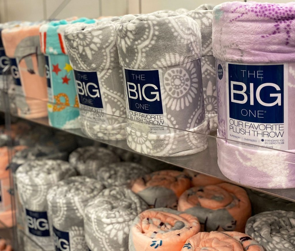 store display shelves full of the big one throw blankets in assorted colors and prints