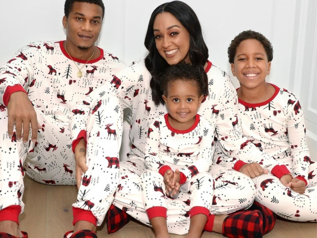 The Children's Place Matching family pajamas on a family of four