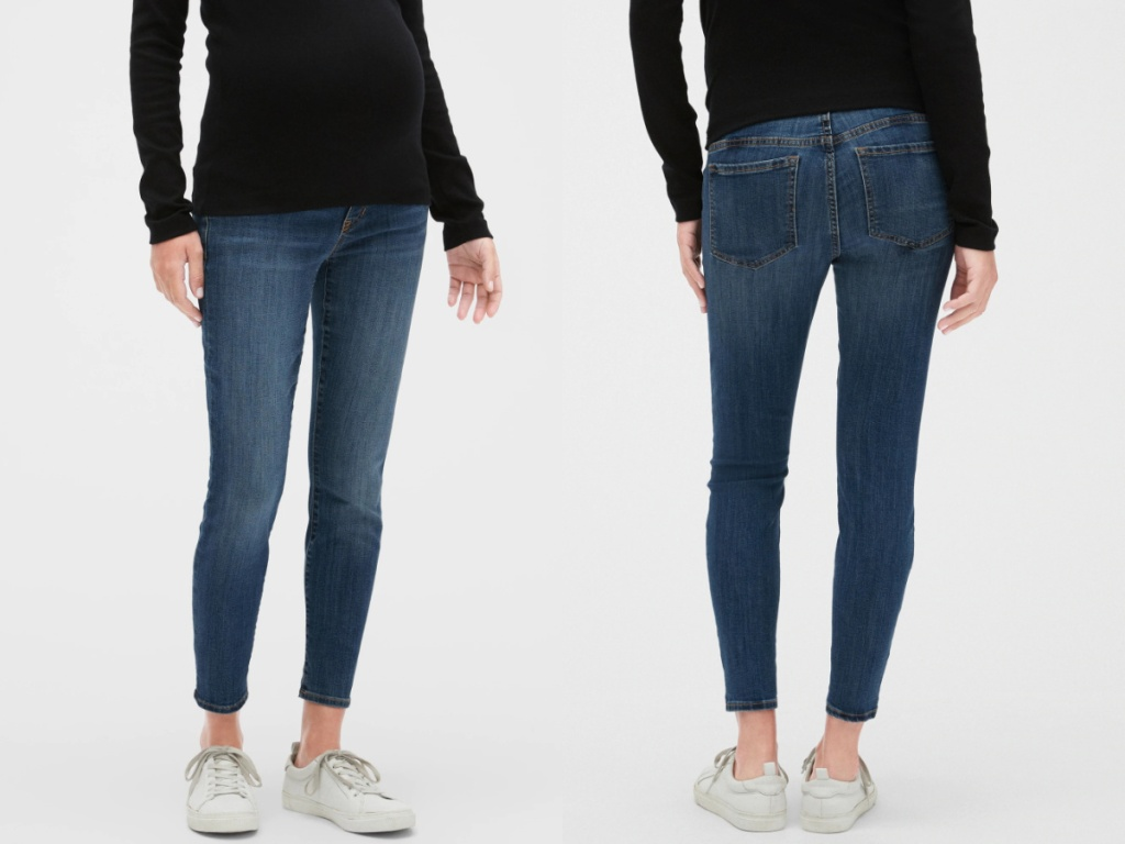 pregnant woman in jeans, black top, and white sneakers