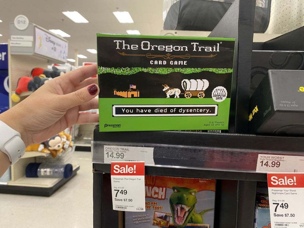 hand holding The Orgeon Trail Game