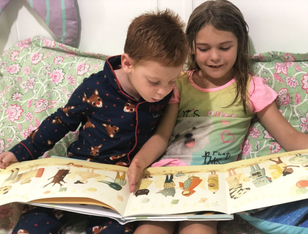boy and girl in pajamas sitting on bed reading The Wonderful Things You Will Be book