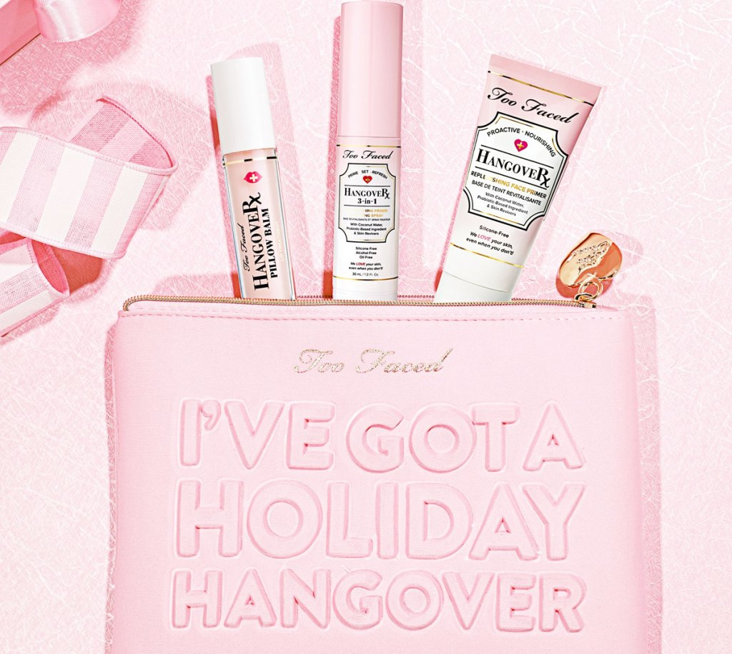 """pink makeup bag that says """"i've got a holiday hangover"""" with three too faced hangover products popping out from the top"""