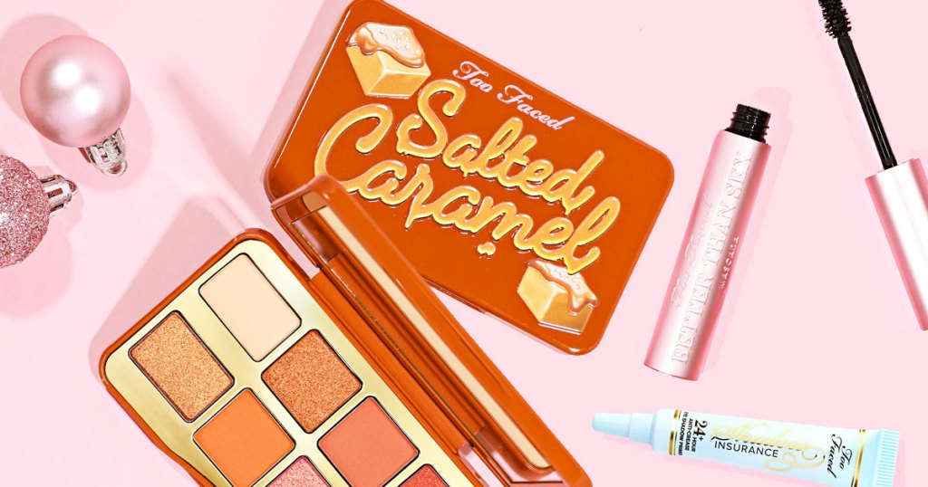too faced salted caramel palette, better than sex mascara, and eyeshadow primer on a pink background
