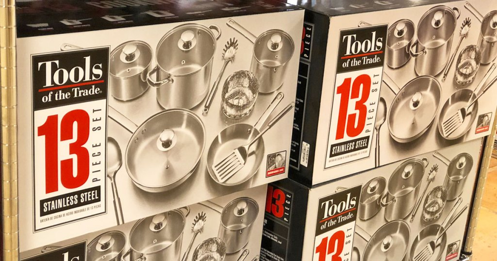 tools of the trade stainless steel cookware set boxes stacked on one another on store display shelf