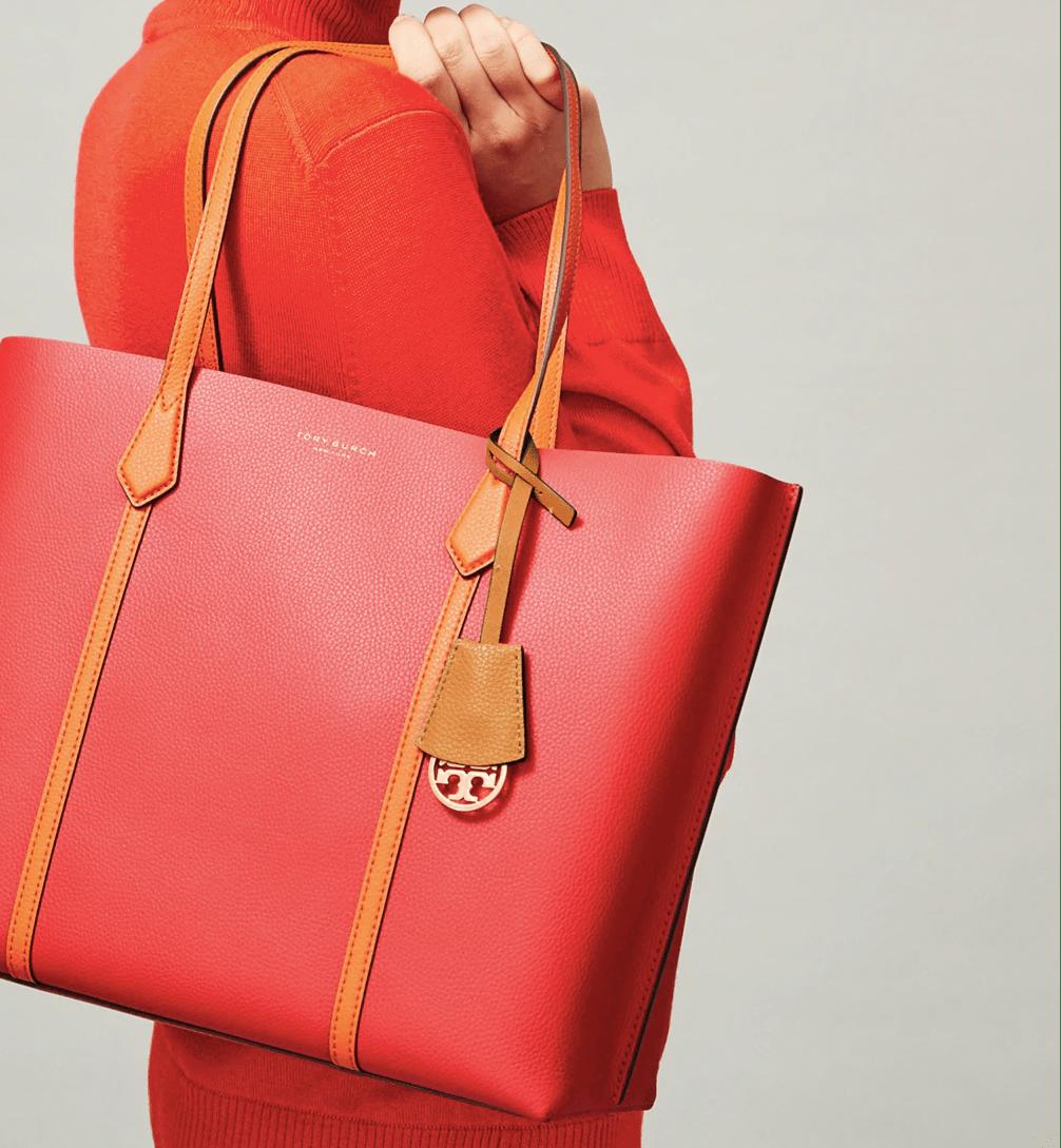 woman carrying a Tory Burch purse