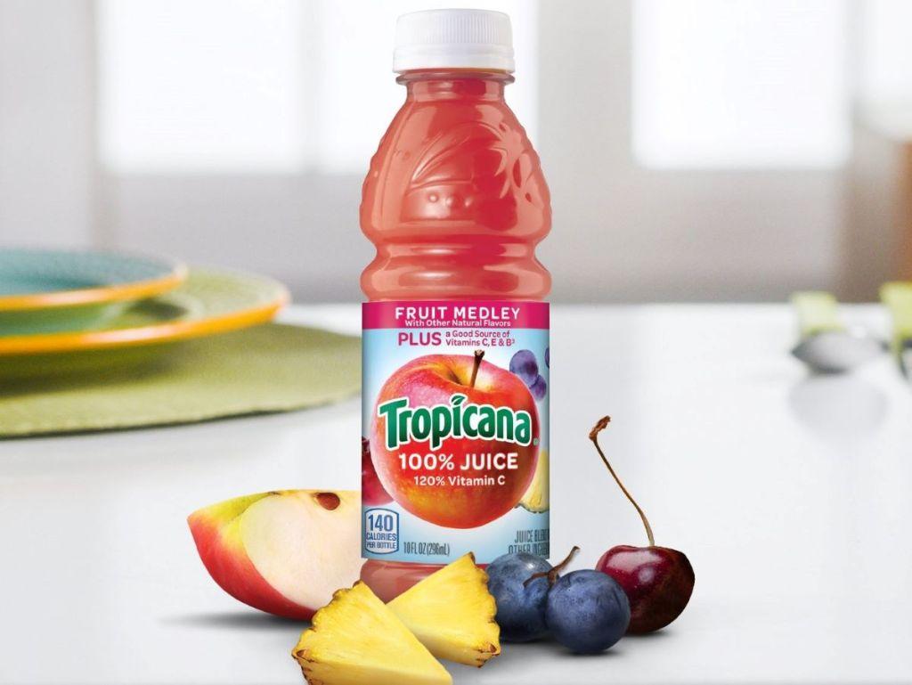 bottle of juice with fruit around it