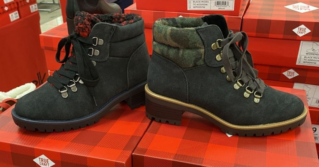 2 styles of True Craft Shearling Hikers on shoeboxes
