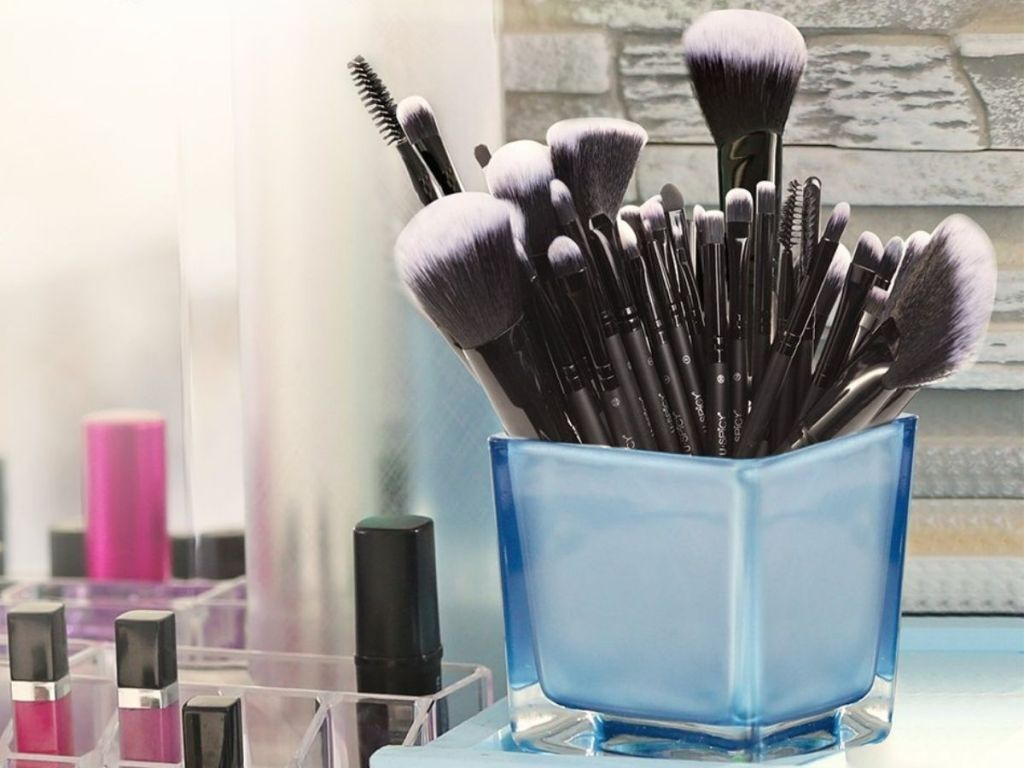 blue cup holding makeup brushes