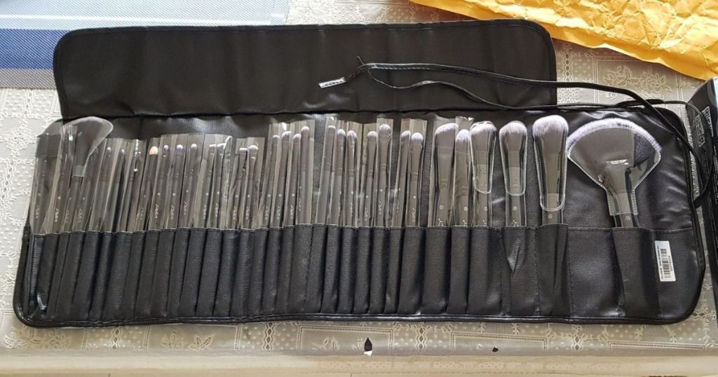 rolled out bag holding lots of makeup brushes