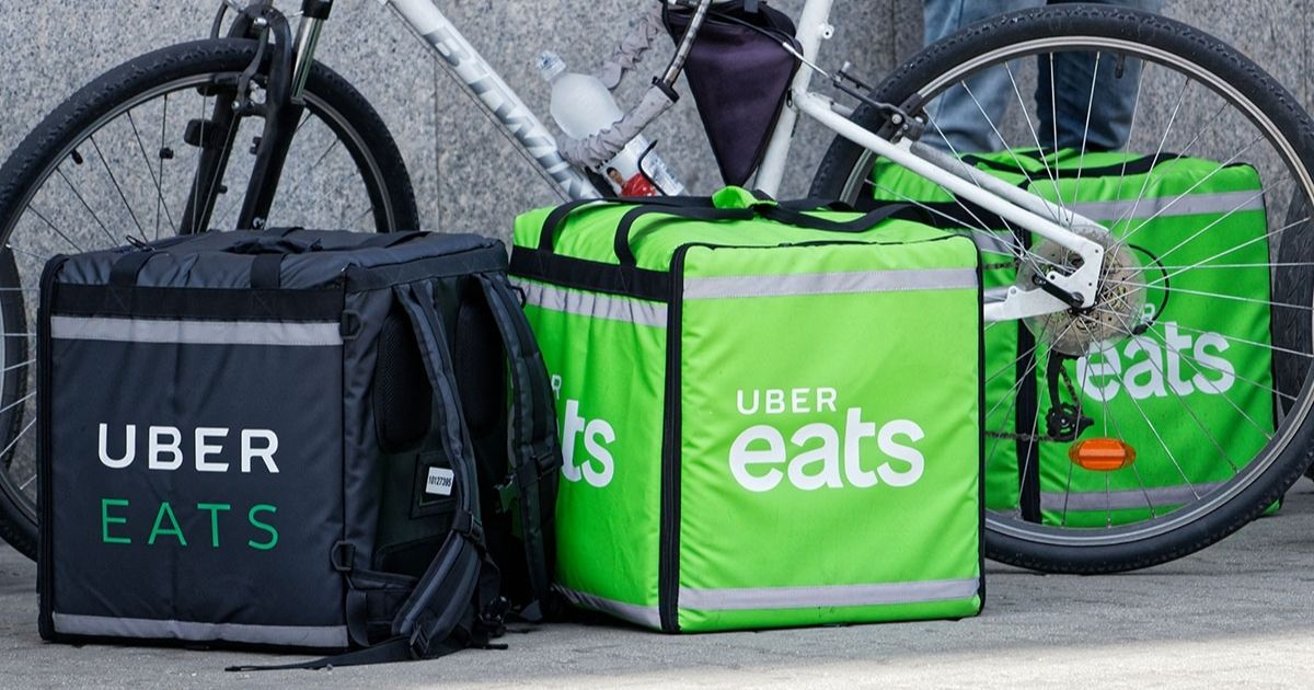 Uber Eats delivery bags by a bike