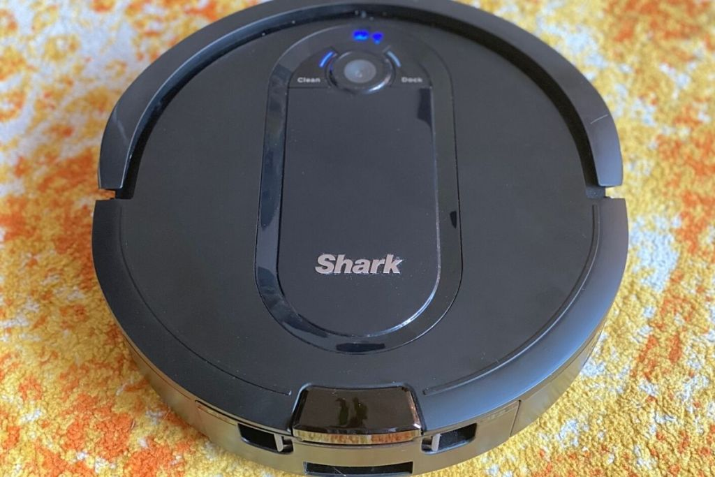 A robot vacuum on a rug