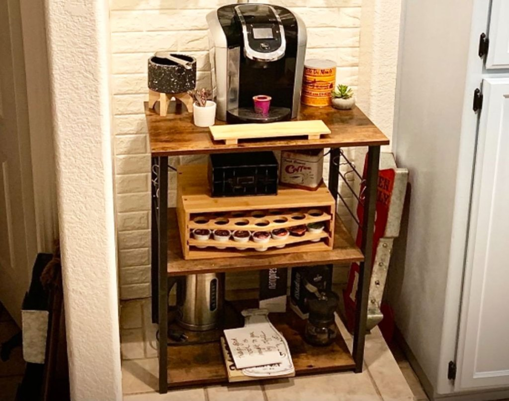three tier kitchen cart with black keurig and coffee accessories on it