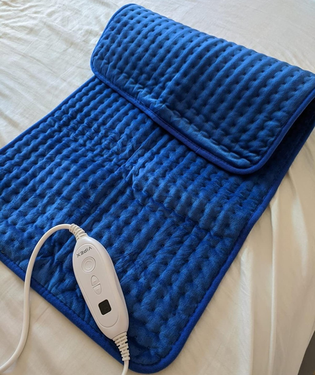 heating pad sitting on a bed