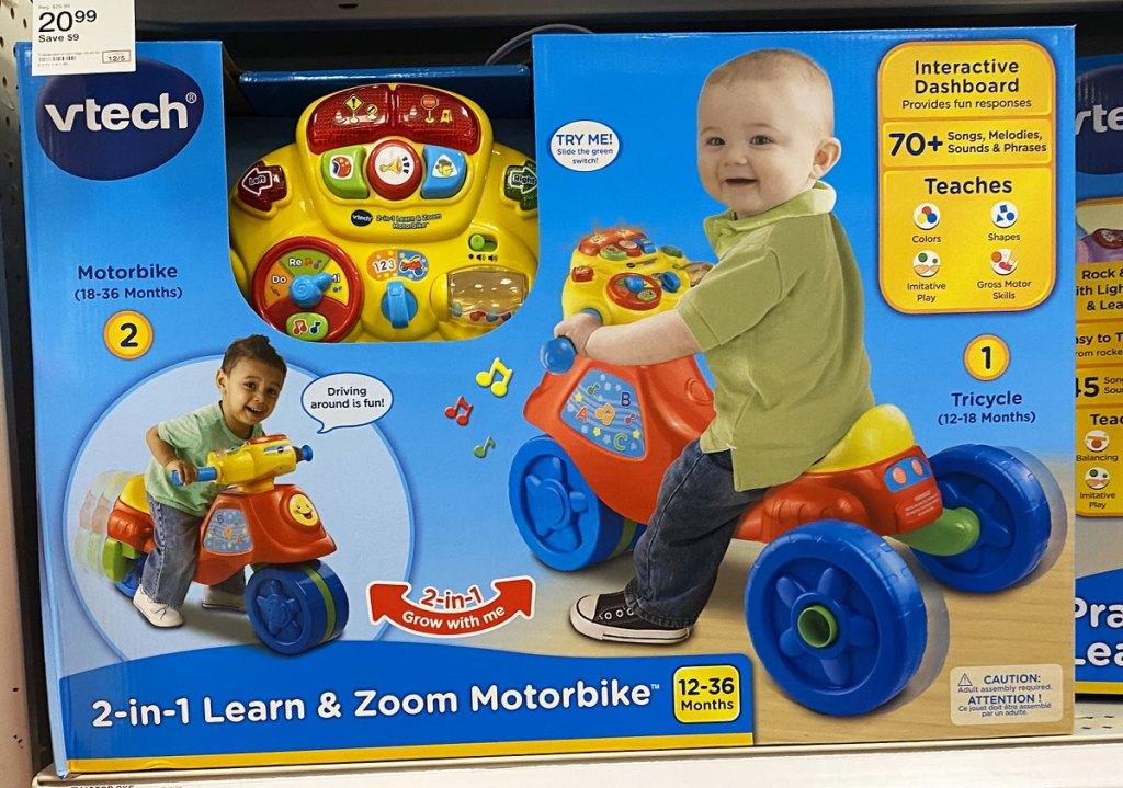 Vtech kids blue, yellow, and ride bike on shelf at target