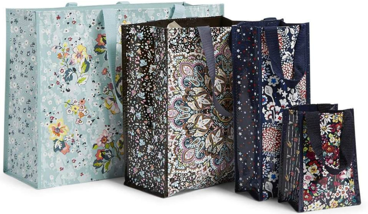 Four reusable tote bags in various sizes