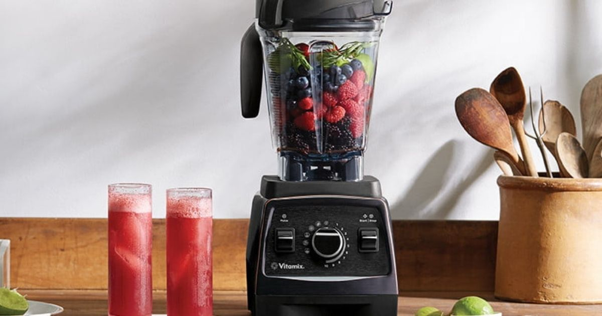 Vitamix E320 with red smoothies on counter