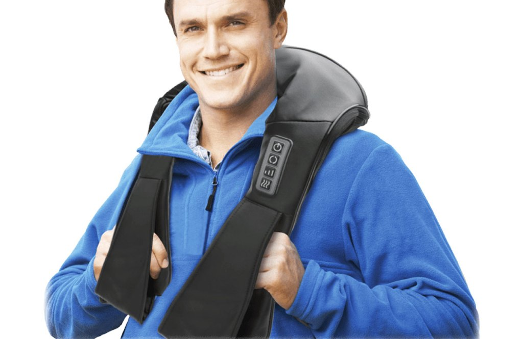 man in blue sweatshirt using a black massager on neck and shoulders