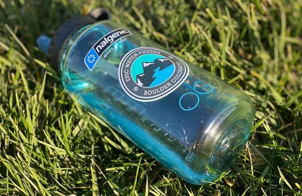 A water bottle in grass