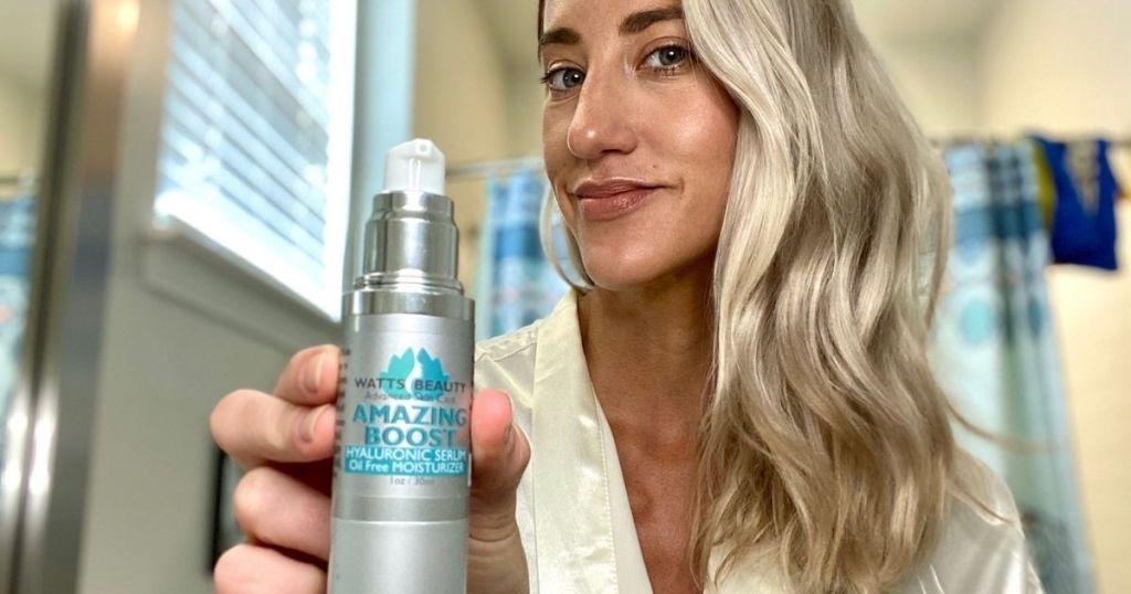 woman holding a bottle of Watts Beauty Hyaluronic Serum