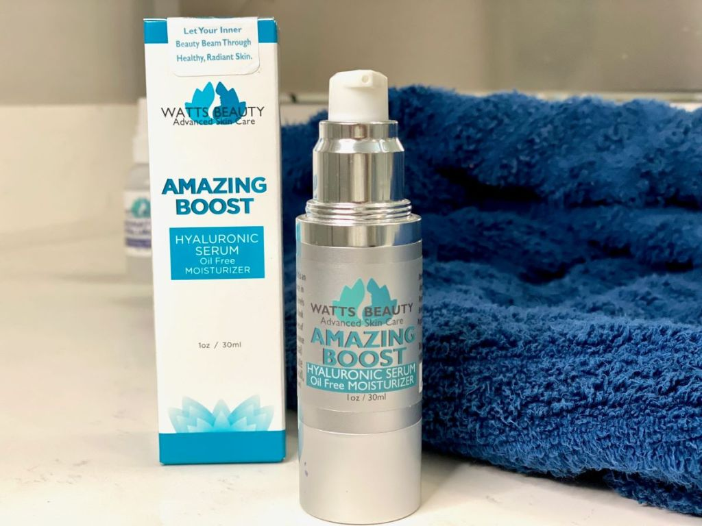 Watts Beauty Hyaluronic Serum bottle and box next to a towel