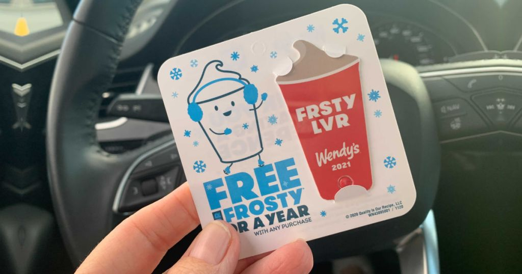Woman holding Wendy's Frosty Tag inside car