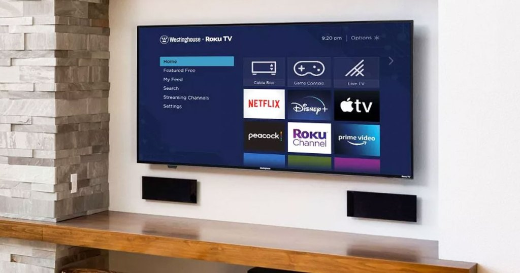 westinghouse tv mounted on wall with roku streaming apps on the screen