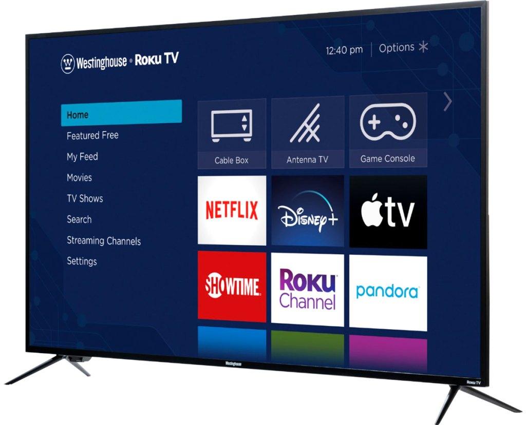 TV layar datar dengan aplikasi melesat roku di layar