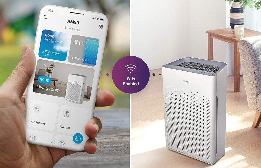 hand holding a phone with an image of an air purifier next to it