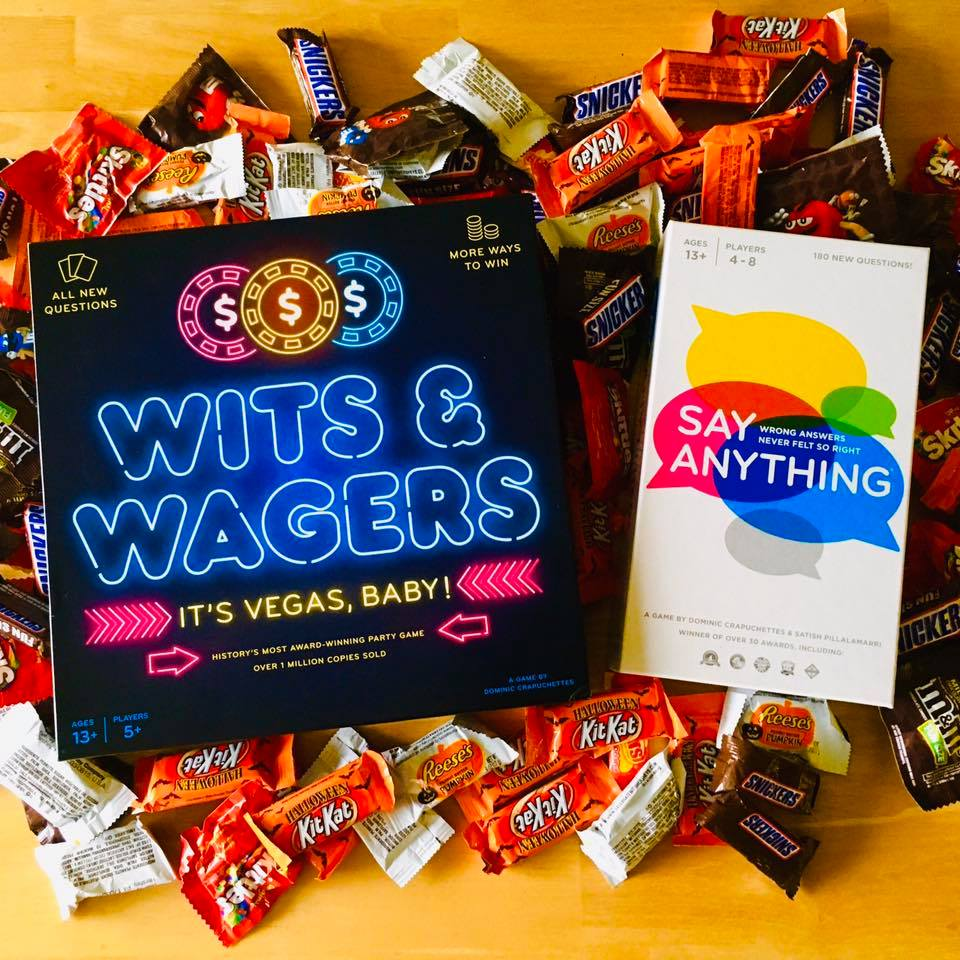 Wits and Wagers and Say Anything Games on a pile of candy