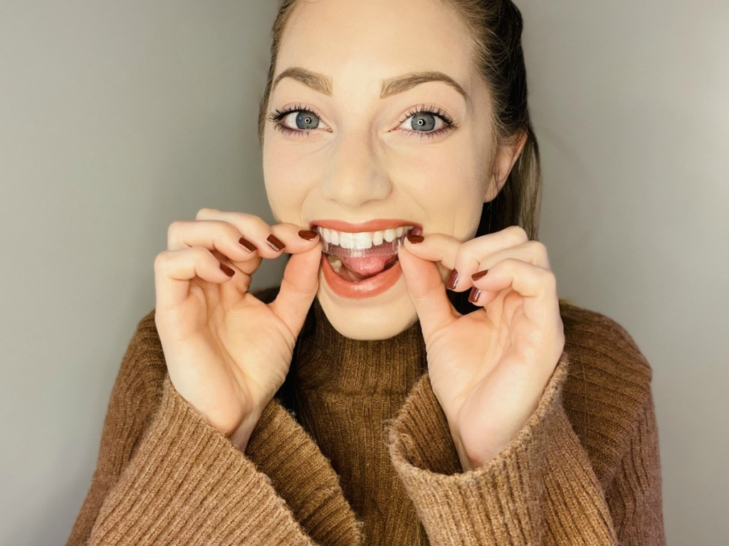 woman putting on crest whitestrips