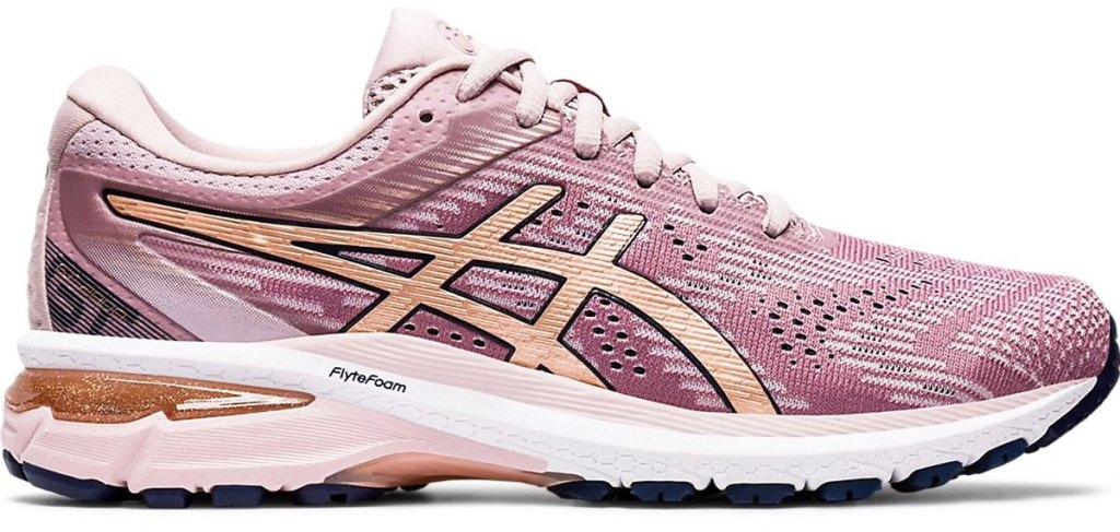 light pink mesh running shoe with light orange asics stripes and white foam sole