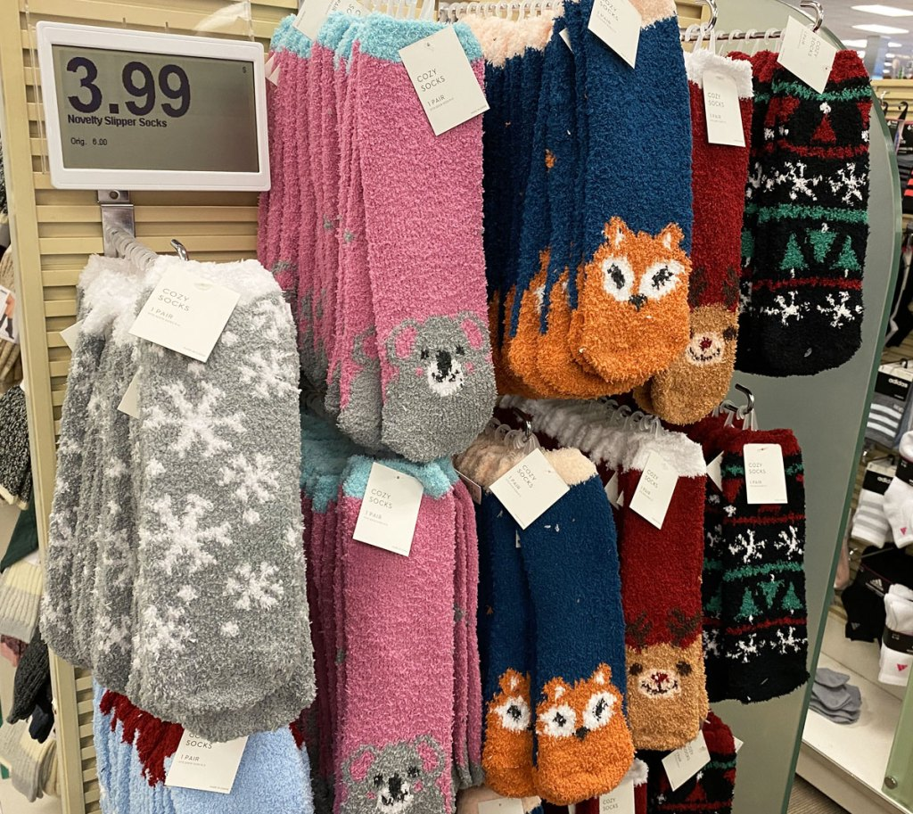 pairs of fuzzy socks with animals at tips of toes hanging on display at kohl's
