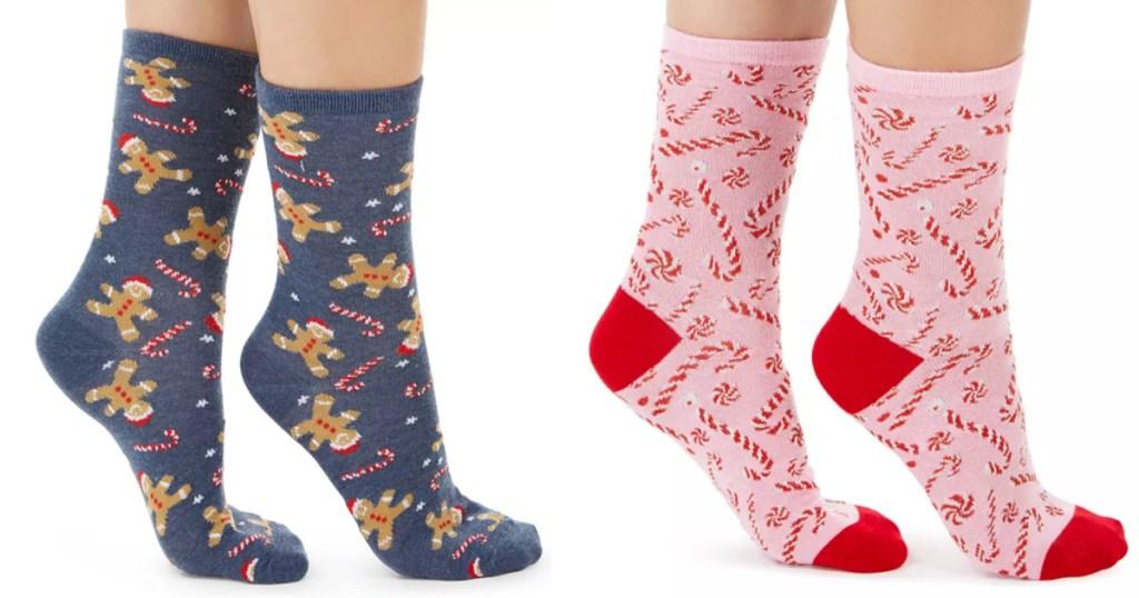 2 women wearing christmas socks