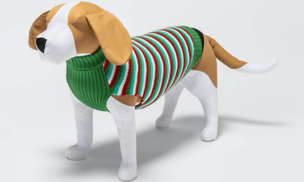 dog toy dressed in red, green, and white striped holiday sweater