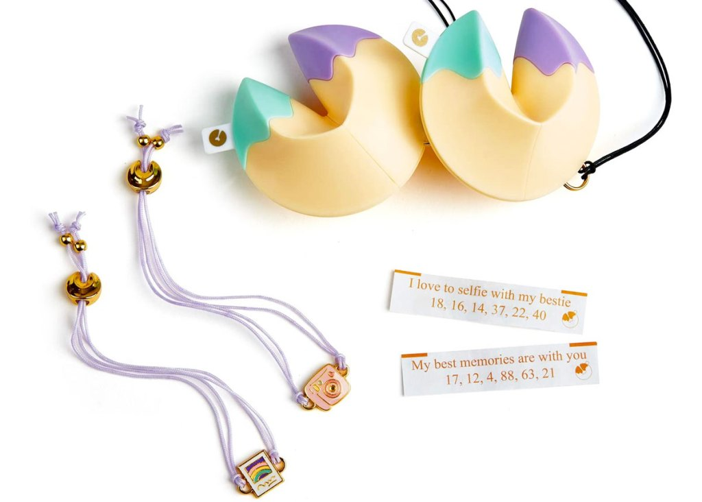 two fortune cookie shaped toys with bff bracelets and fortunes