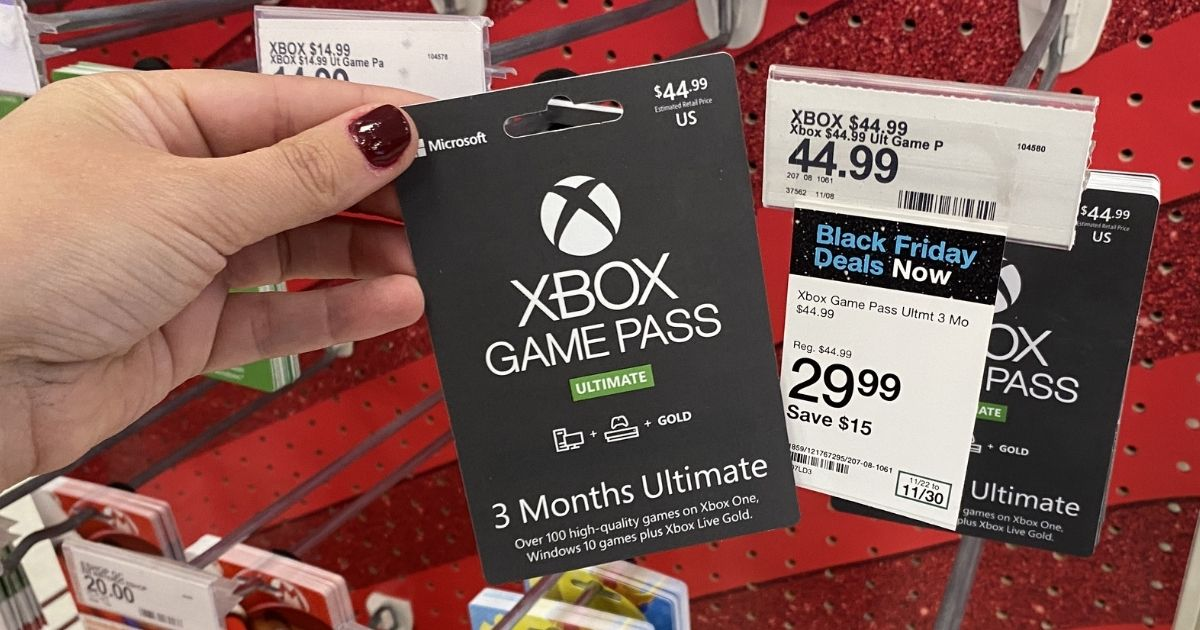 hand holding Xbox Game Pass Ultimate Membership