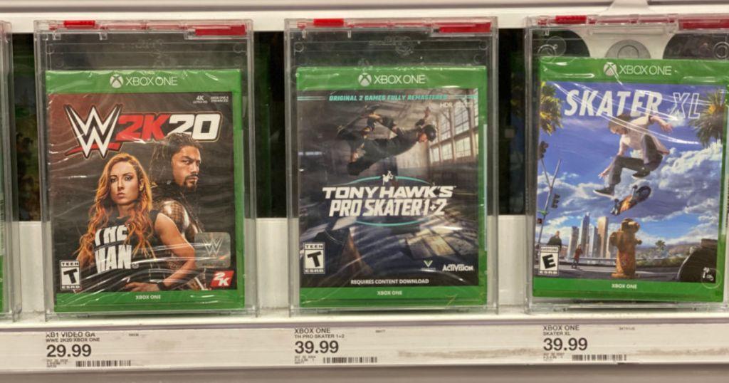three xbox games on shelf