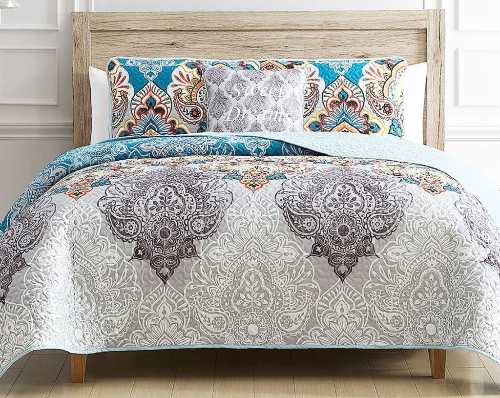 white and grey quilt set with multi-color print at center with matching pillow shams and throw pillow