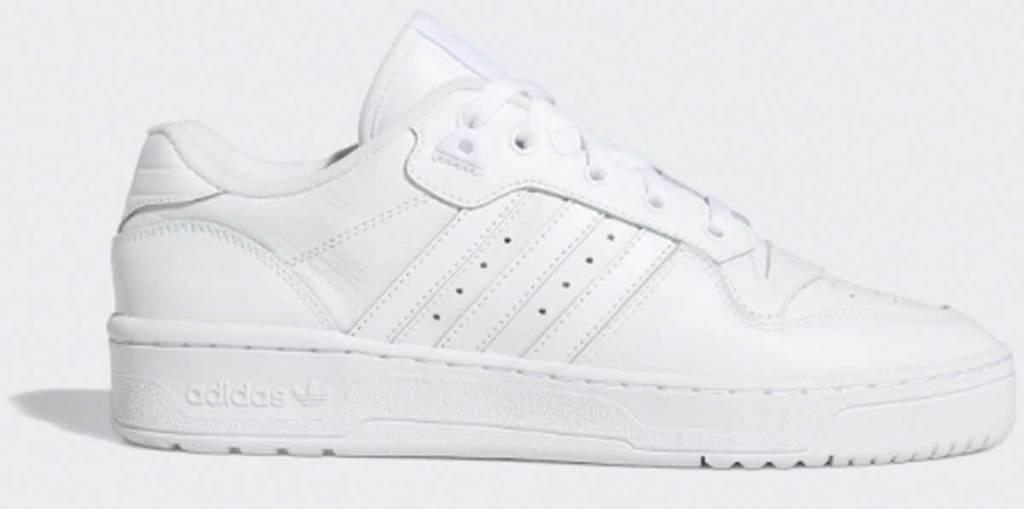 white men's adidas shoe stock image