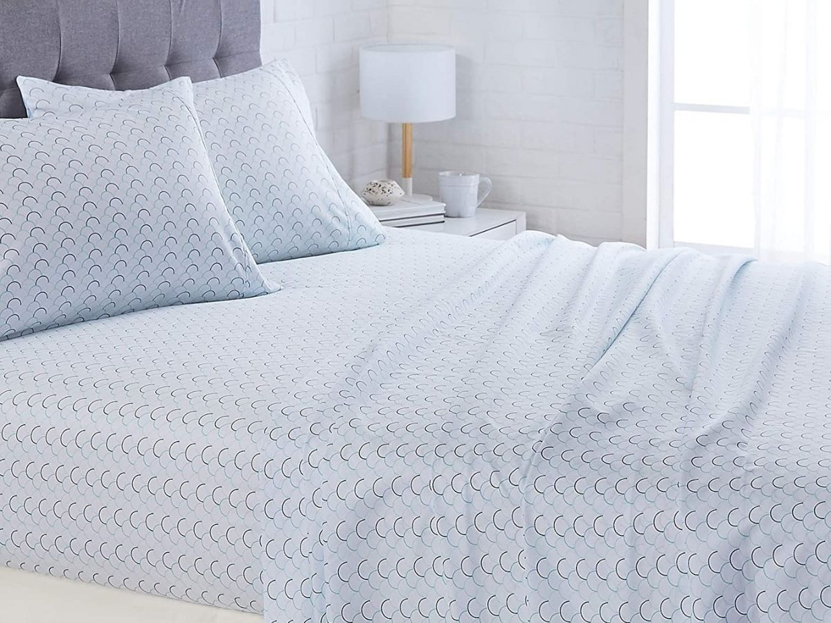 blue scallop sheets on bed