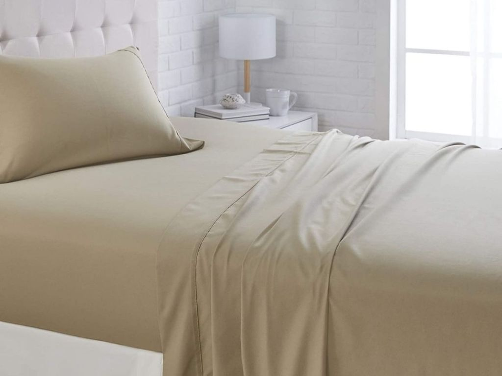 olive colored sheets on bed