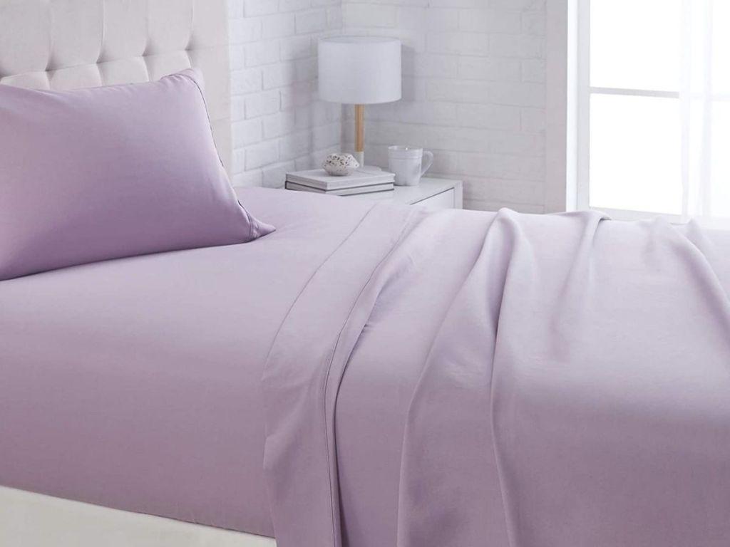 lavender sheet set on bed