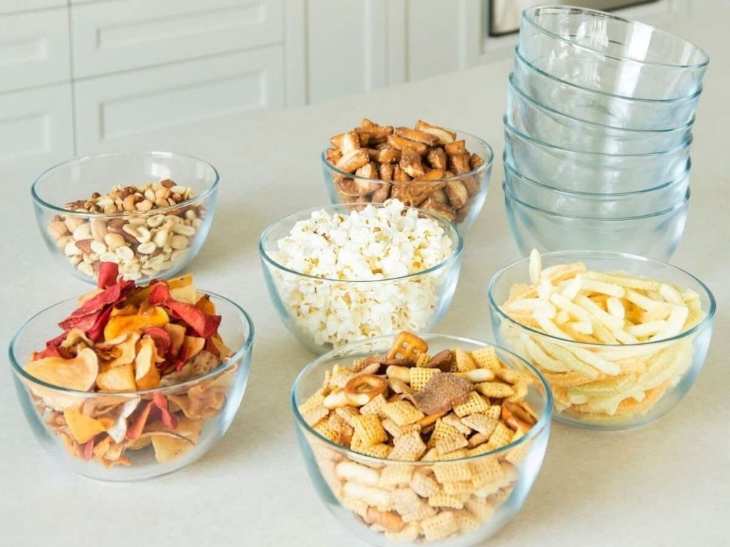 glass bowls filled with snacks