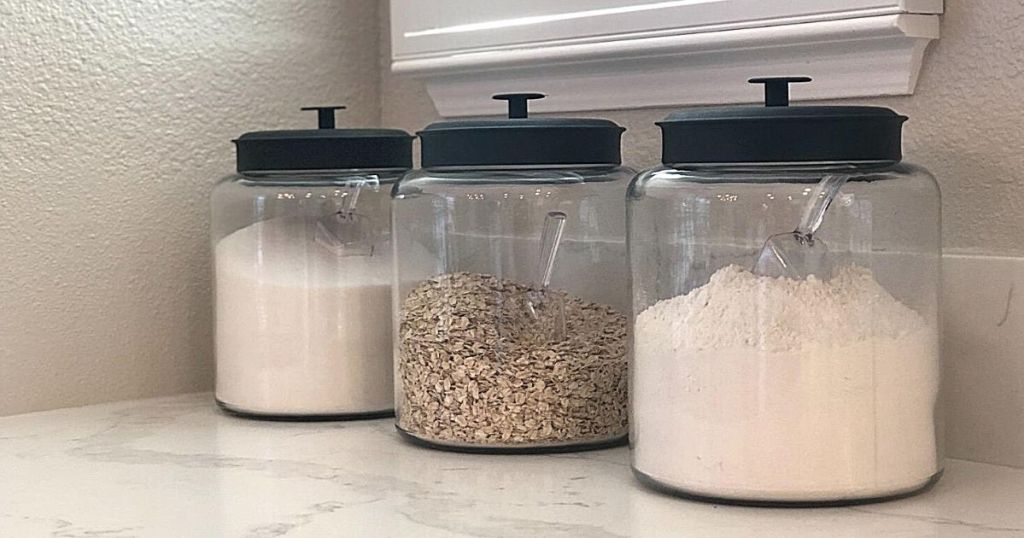 glass jars with black lids filled with ingredients