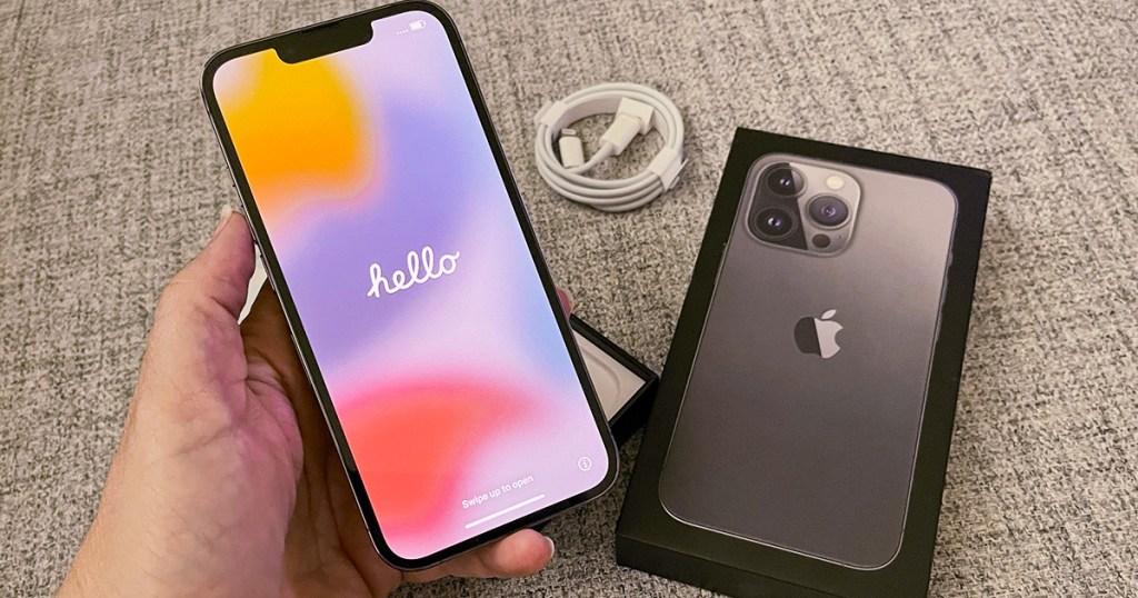 hand holding apple iphone 13