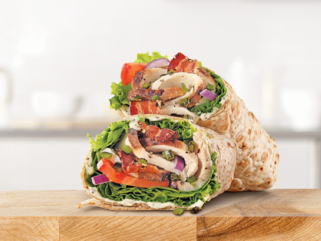 chicken, bacon and tomatoes wrapped up in tortilla